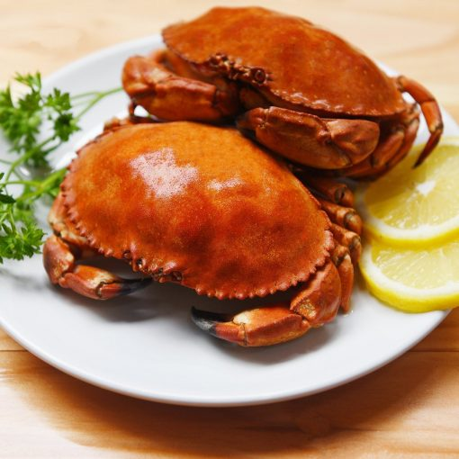 Cooked Crab On Plate With Lemon Herbs And Spices On The Wooden D